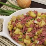 Corned Beef Hash in a white ceramic serving dish